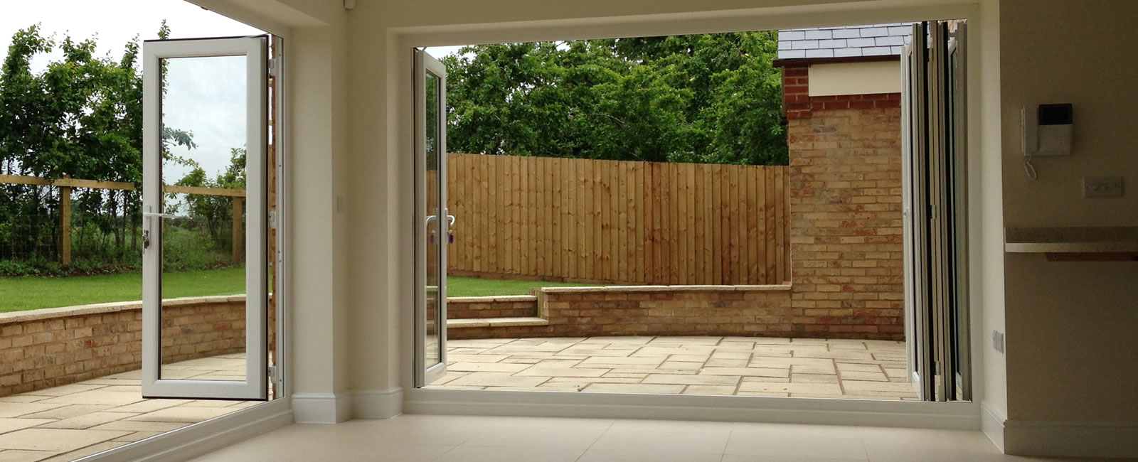 Full length folding patio doors